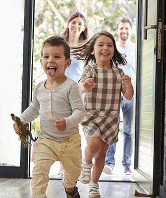 Children running and smiling in hallway