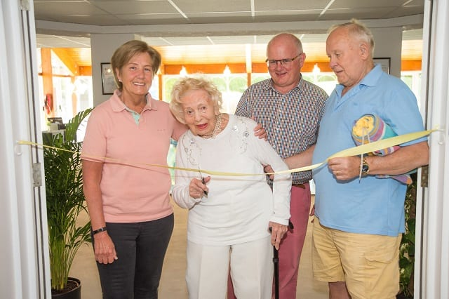 Residents cutting the ribbon