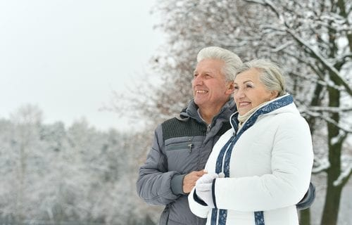 Retired couple in the snow