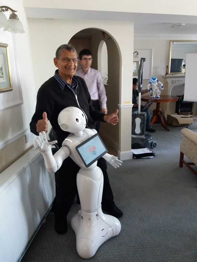 Resident, Haroun Mohammad interacting with Pepper