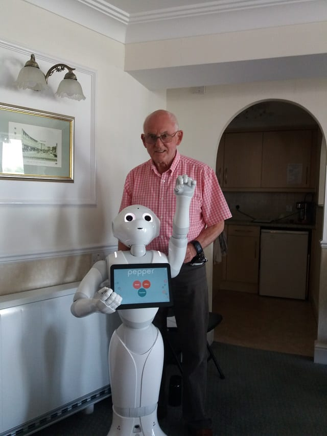 Resident, John Overton interacting with Pepper